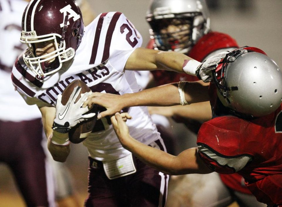 Ada's Dillon Holder (28) breaks away from a Grant defender during a high school football game between Ada and U.S. Grant at C.B. Speegle Stadium in Oklahoma City, Friday, Sept. 16, 2011. Photo by Nate Billings, The Oklahoman  ORG XMIT: KOD
