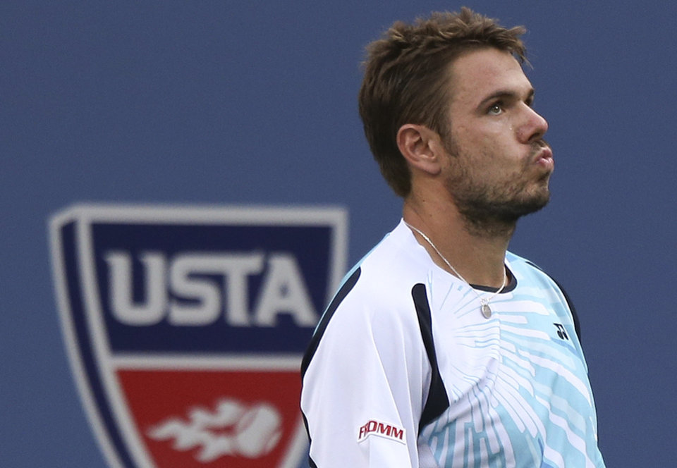 Photo - Stan Wawrinka, of Switzerland, reacts after a shot against Kei Nishikori, of Japan, during the quarterfinals of the 2014 U.S. Open tennis tournament, Wednesday, Sept. 3, 2014, in New York. (AP Photo/Mike Groll)
