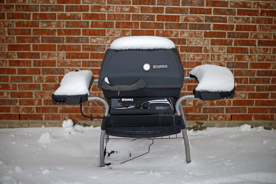 A gas grill is covered in snow outside a northwest Oklahoma City area neighborhood near 164th and Pennsylvania after winter storm moved through the area, Friday, December 6, 2013. Photo by Bryan Terry, The Oklahoman
