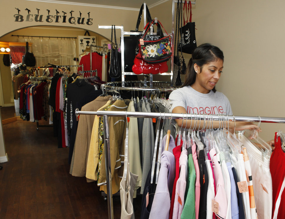 Photo - Melody Seeley looks at clothes at BLUEtique, a resale shop that opened this week at NW 23 and Virginia on the Oklahoma City University campus.   PHOTOS BY PAUL HELLSTERN, THE OKLAHOMAN