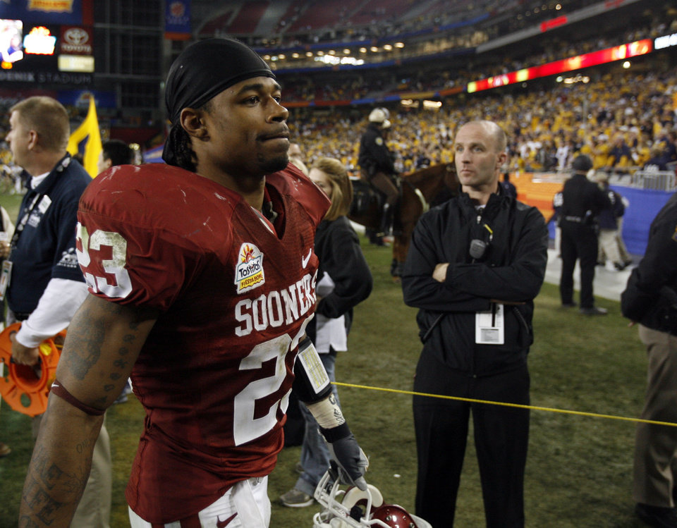 Photo - Running back Allen Patrick leaves the field at the conclusion of the Fiesta Bowl college football game between the University of Oklahoma Sooners (OU) and the West Virginia University Mountaineers (WVU) at The University of Phoenix Stadium on Wednesday, Jan. 2, 2008, in Glendale, Ariz. 