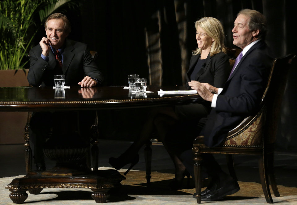 Journalist Charlie Rose, right, smiles as he interviews Robert F. Kennedy, Rory Kennedy, center, and Robert F. Kennedy Jr. in front of a full audience at the AT&T Performing Arts Center Friday, Jan. 11, 2013, in Dallas. The Kennedys are in Dallas as a year of observances begins for the 50th anniversary of President John F. Kennedy's assassination. (AP Photo/Tony Gutierrez)