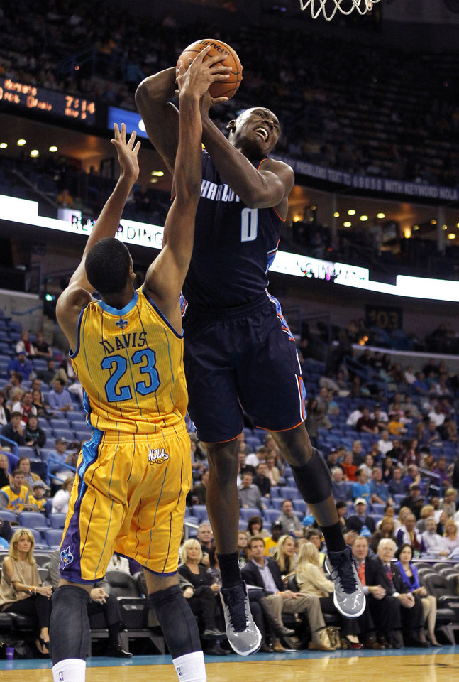 New Orleans Hornets power forward Anthony Davis (23) prevents Charlotte Bobcats power forward Bismack Biyombo (0) for driving to the basket in the first half of an NBA basketball game in New Orleans, Friday, Nov. 9, 2012. (AP Photo/Gerald Herbert)