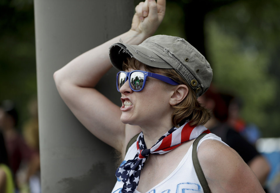 Photo - A supporter of Sen. Bernie Sanders, I-Vt., yells at delegates through the fence at Franklin Delano Roosevelt Park in Philadelphia, Tuesday, July 26, 2016, during the second day of the Democratic National Convention. (AP Photo/Matt Slocum)