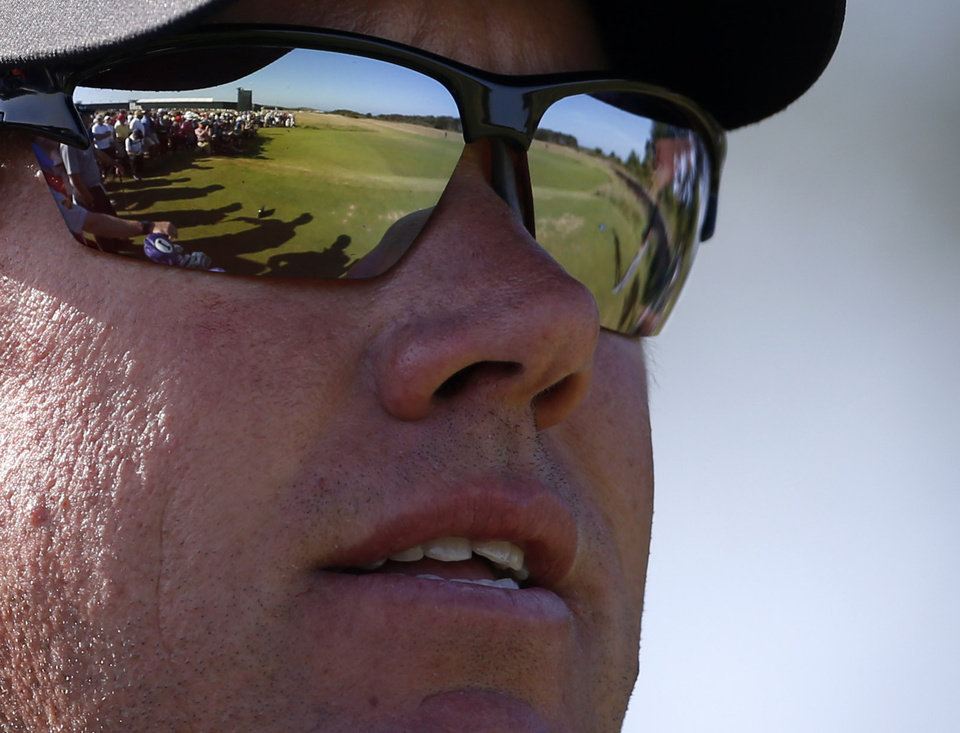 Photo - Lee Westwood of England waits to play off the second tee with the fairway reflected in his sunglasses during the second round of the British Open Golf Championship at Muirfield, Scotland, Friday July 19, 2013. (AP Photo/Peter Morrison)