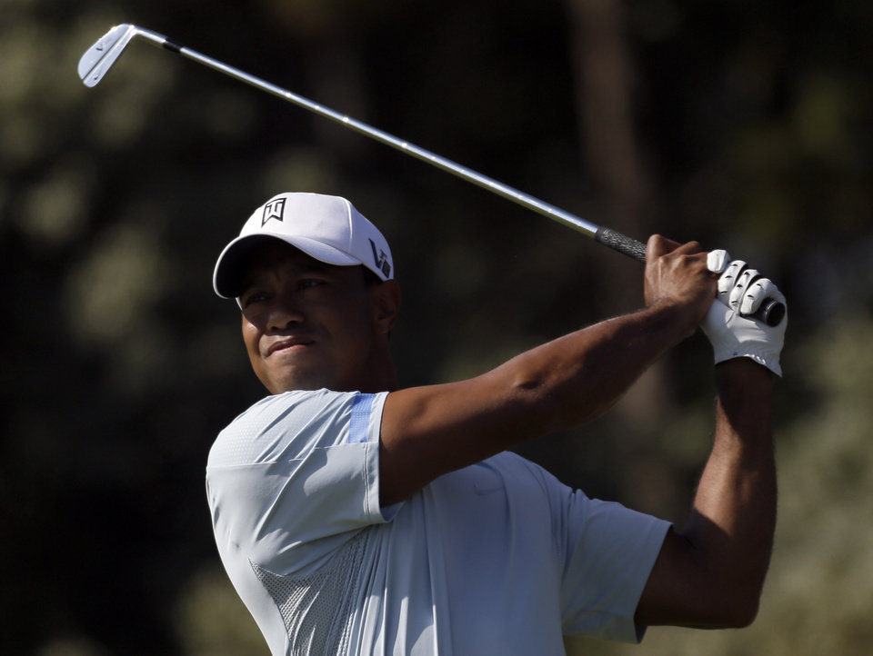 Photo - Tiger Woods of the United States plays a shot off the third tee during the second round of the British Open Golf Championship at Muirfield, Scotland, Friday July 19, 2013. (AP Photo/Jon Super)