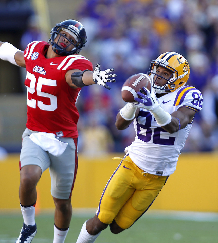LSU wide receiver James Wright (82) pulls in a 48-yard pass reception in front of Mississippi defensive back Cody Prewitt (25) in the first half of their NCAA college football game in Baton Rouge, La., Saturday, Nov. 17, 2012. (AP Photo/Gerald Herbert)