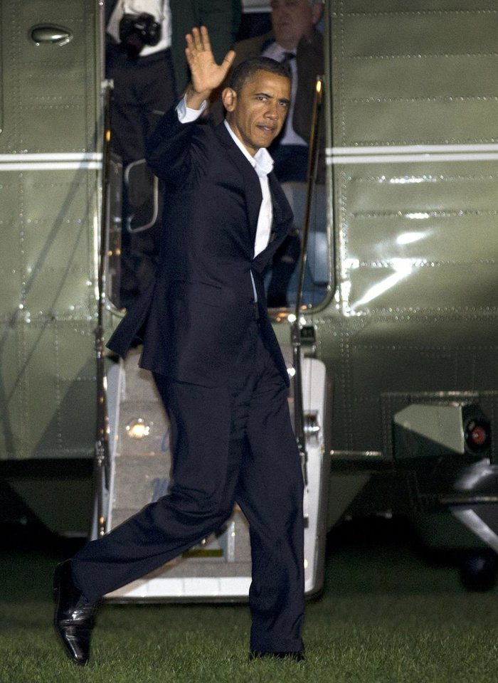 President Barack Obama waves as he exits the Marine One helicopter on the South Lawn of the White House in Washington, Friday, Nov. 2, 2012, after days of campaigning. (AP Photo/Jacquelyn Martin)