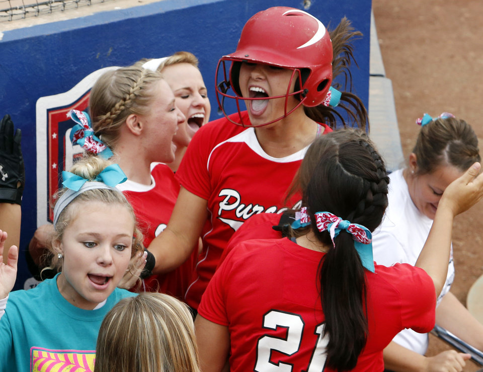 Purcell's Kaylin Taylor celebrates her score against Tuttle in the first round at the 2012 State Fast-Pitch Softball Tournament on Thursday, Oct. 11, 2012 at ASA Hall of Stadium in Oklahoma City, Okla.  Photo by Steve Sisney, The Oklahoman