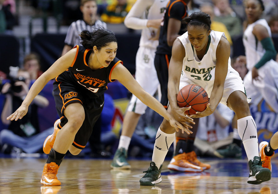 Photo - Oklahoma State's Brittney Martin (22) goes for the ball beside Baylor's Brooklyn Pope (32) during the Big 12 tournament women's college basketball game between Oklahoma State University and Baylor at American Airlines Arena in Dallas, Sunday, March 10, 2012.  Oklahoma State lost 77-69. Photo by Bryan Terry, The Oklahoman