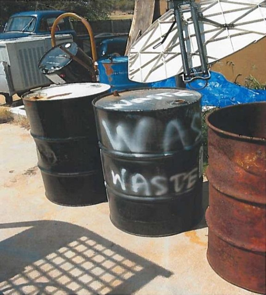 Photo -  A steel drum labeled