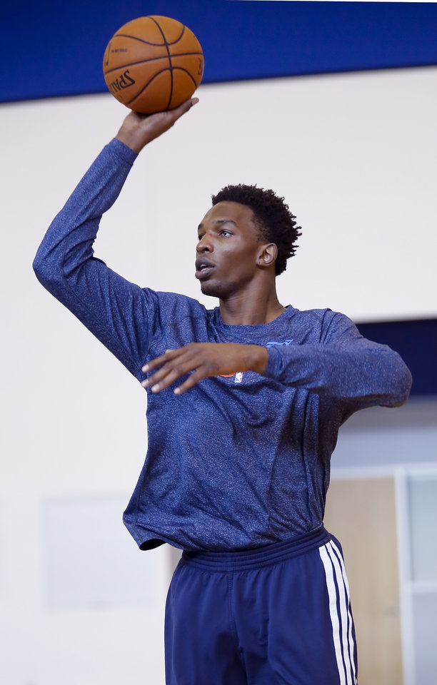 Photo - Hasheem Thabeet shoots the ball during media availability at the Oklahoma City Thunder practice facility on Friday, May 30, 2014 in Oklahoma City, Okla. PHOTO BY CHRIS LANDSBERGER, The Oklahoman