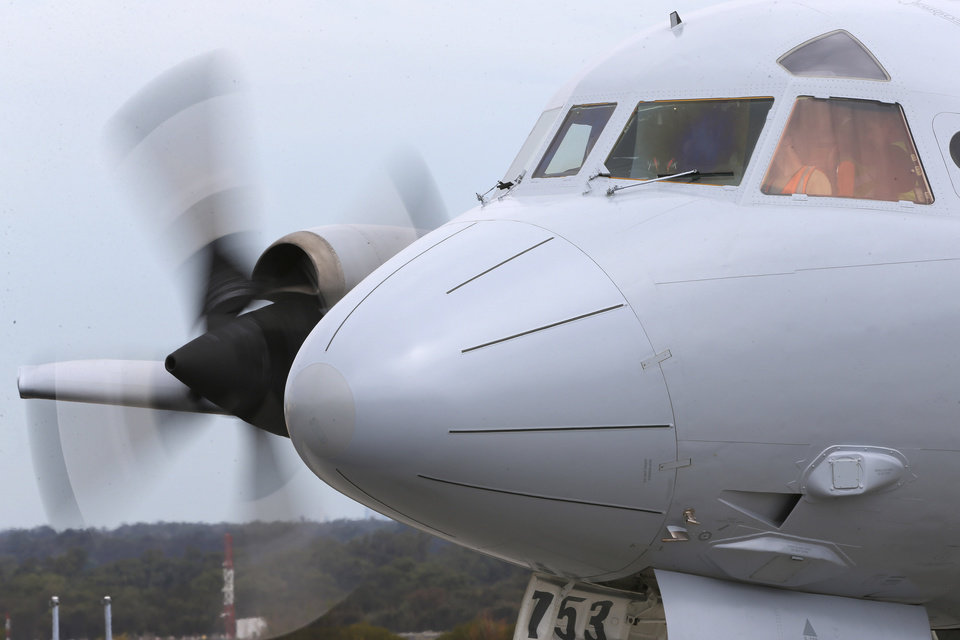 Photo - A Royal Australia Air Force AP-3C Orion runs its engines for maintenance during a no fly day in the search for missing Malaysia Airlines flight MH370 in Perth, Australia, Tuesday, March 25, 2014. All search and rescue flights were canceled Tuesday due to bad wether in the search area.(AP Photo/Rob Griffith)