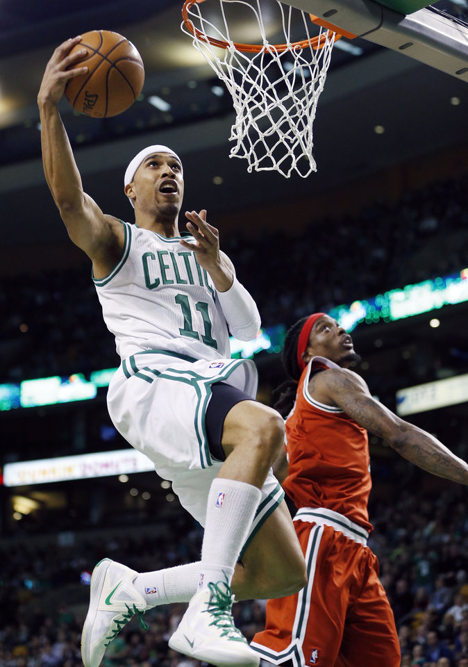 Boston Celtics' Courtney Lee (11) shoots past Milwaukee Bucks' Marquis Daniels, right, in the first quarter of an NBA basketball game in Boston, Friday, Dec. 21, 2012. (AP Photo/Michael Dwyer)