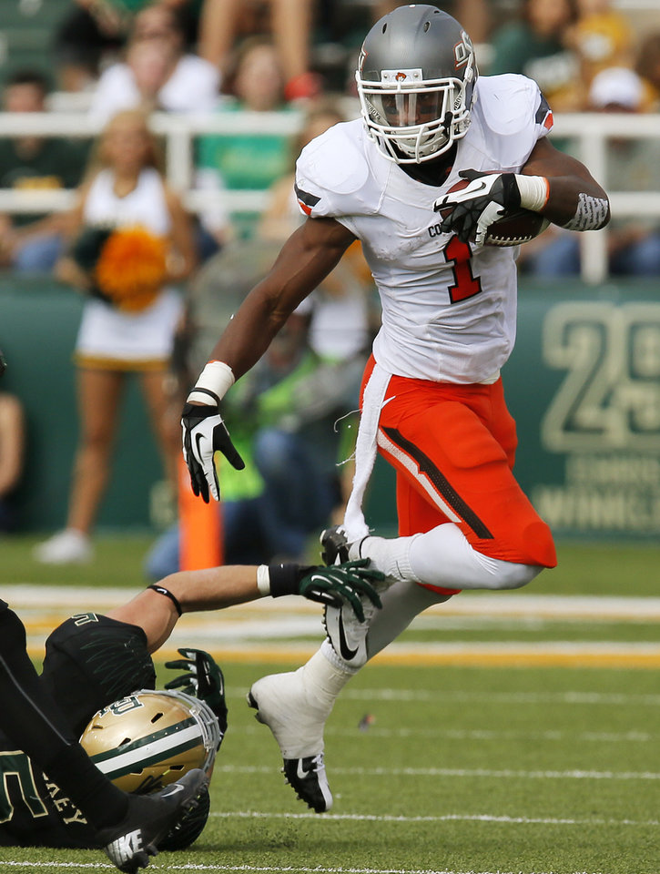 Oklahoma State\'s Joseph Randle (1) runs past Baylor\'s Eddie Lackey (5) during a college football game between the Oklahoma State University Cowboys (OSU) and the Baylor University Bears at Floyd Casey Stadium in Waco, Texas, Saturday, Dec. 1, 2012. Photo by Nate Billings, The Oklahoman