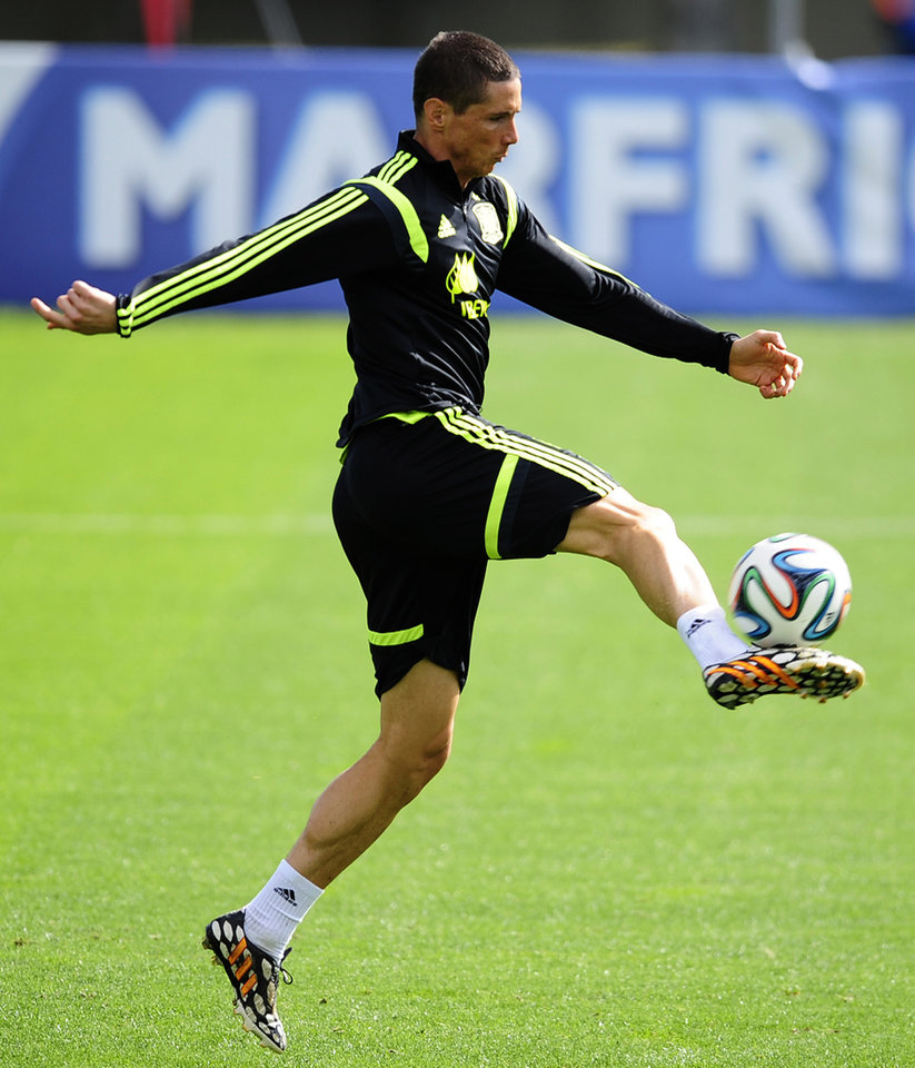 Photo - FILE - File photo dated Saturday June 21, 2014, Spain's Fernando Torres kicks the ball during a training session at the Atletico Paranaense training center in Curitiba, Brazil.  According to an announcement released by Chelsea soccer club Friday Aug. 29, 2014, Italian club AC Milan have agreed terms for a two-year loan deal for striker Fernando Torres. (AP Photo/Manu Fernandez, FILE)