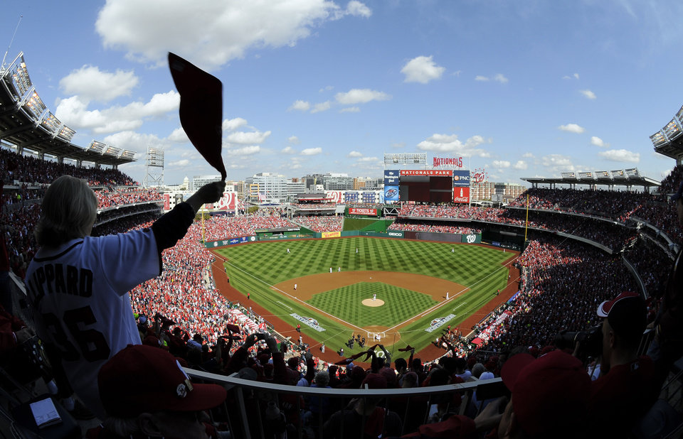 Photo -   A fan waves a towel in the stands during Game 3 of the National League division baseball series between the Washington Nationals and the St. Louis Cardinals on Wednesday, Oct. 10, 2012, in Washington. (AP Photo/Nick Wass)