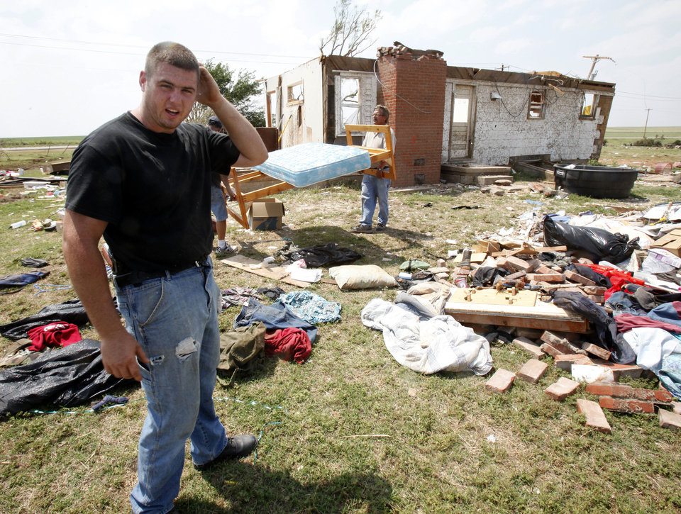 Photo - Matthew Apel stands outside the remains of his parents' house in rural Guthrie on May 28. PHOTO BY PAUL HELLSTERN, THE OKLAHOMAN ARCHIVES