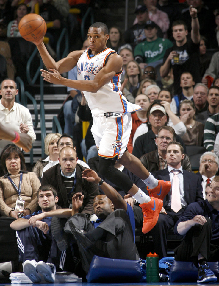 Oklahoma City's Russell Westbrook passes the ball during the NBA basketball game between the Oklahoma City Thunder and the Dallas Mavericks at the Ford Center in Oklahoma City on Wednesday, December 16, 2009. Photo by Bryan Terry, The Oklahoman ORG XMIT: KOD