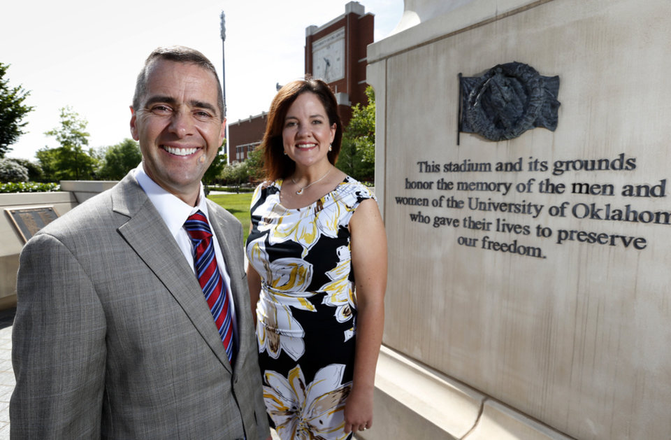 Photo - Shad Satterthwaite, professor and National Guard member, and Jennifer Trimmer, veteran student services coordinator, are seen at the veterans memorial north of Gaylord Family — Oklahoma Memorial Stadium at the University of Oklahoma on June 25, 2014, in Norman.  Photo by Steve Sisney, The Oklahoman  STEVE SISNEY