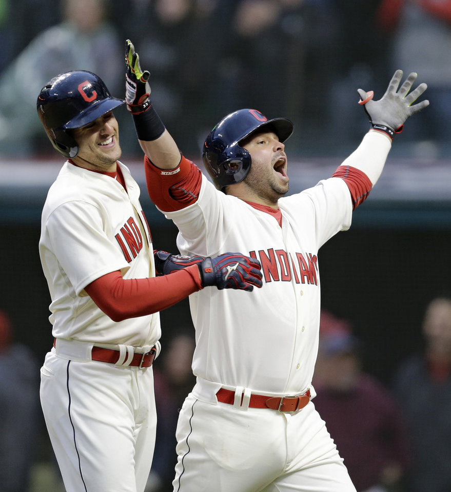 Photo - Cleveland Indians' Nick Swisher, right, looks to the fans as he celebrates with Lonnie Chisenhall after Swisher hit a two-run home run off Minnesota Twins starting pitcher Mike Pelfrey in the sixth inning of a baseball game, Friday, April 4, 2014, in Cleveland. Chisenhall scored. (AP Photo/Mark Duncan)