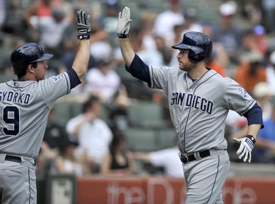 Photo - San Diego Padres' Chase Headley right, celebrates with teammate Jedd Gyorko (9), after hitting a solo home run during the fifth inning of an inter league baseball game against the Chicago White Sox in Chicago, Sunday, June 1, 2014. (AP Photo/Paul Beaty)