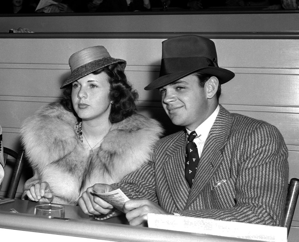 FILE - In this May 30, 1939 file photo, actress Deanna Durbin sits with Vaughn Paul in the clubhouse of Hollywood Park in Los Angeles. Paul was Durbin\'s first husband. Durbin, the internationally famous child star from Hollywood\'s Golden Age who brought her pure soprano voice and natural, girl-next-door looks to nearly 30 movies, died in April 2013. Family friend Bob Koster, whose father directed six of Durbin\'s films, tells The Associated Press on Wednesday May 1, 2013 that she died at age 91 in a village outside Paris in April. (AP File Photo)
