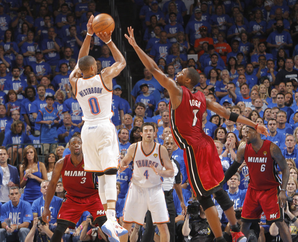Oklahoma City's Russell Westbrook (0) puts up a shot over Miami's Chris Bosh (1) during Game 1 of the NBA Finals between the Oklahoma City Thunder and the Miami Heat at Chesapeake Energy Arena in Oklahoma City, Tuesday, June 12, 2012. Photo by Chris Landsberger, The Oklahoman