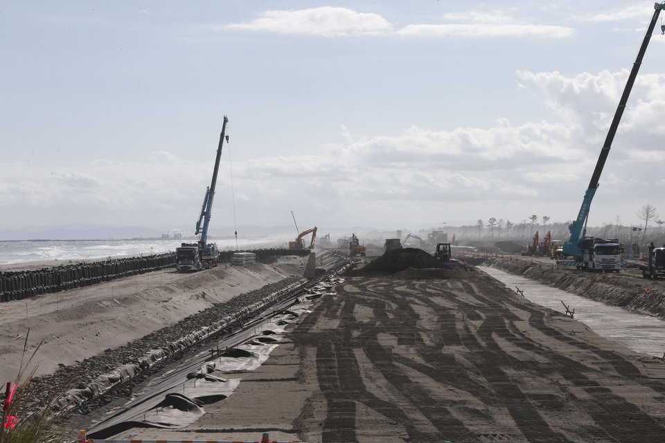 Photo -   In this Oct. 9, 2012 photo, construction works go on along the Arahama beach, severely damaged by the March 11, 2011 earthquake and tsunami, in Sendai, northeastern Japan. Japan's accounting of its budget for reconstruction from the disasters is crammed with spending on unrelated projects, while all along Japan's northeastern coast, dozens of communities remain uncertain of whether, when and how they will rebuild. (AP Photo/Koji Sasahara)