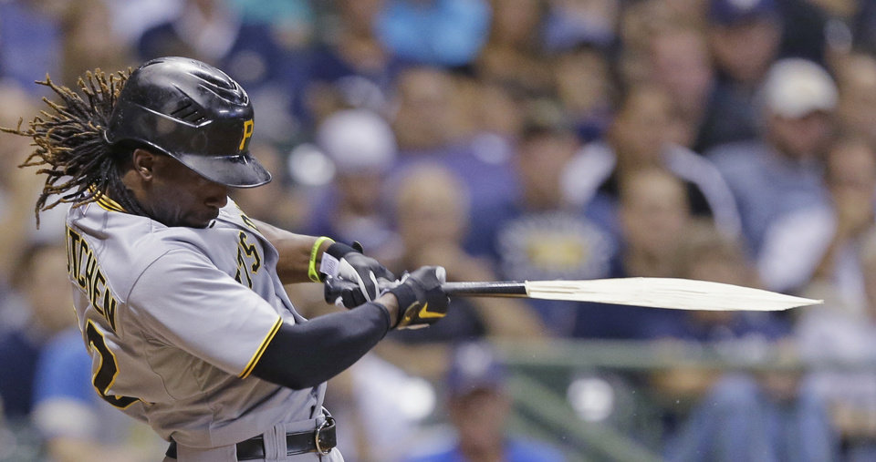 Photo -   Pittsburgh Pirates' Andrew McCutchen breaks his bat during his RBI single against the Milwaukee Brewers during the eighth inning of a baseball game Saturday, Sept. 1, 2012, in Milwaukee. (AP Photo/Jeffrey Phelps)
