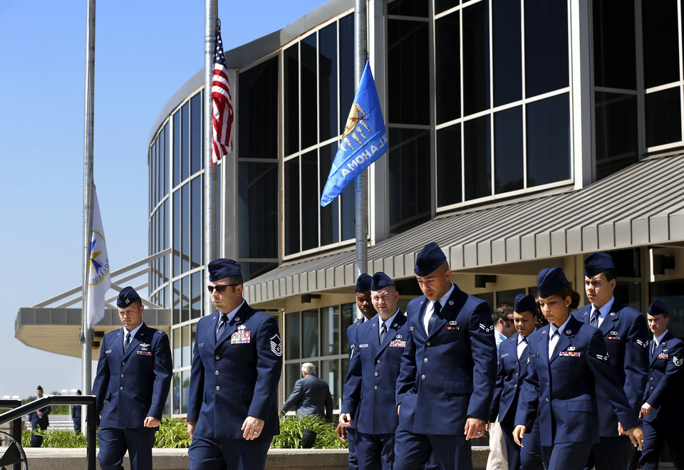 As flags fly at half staff,  Air Force personnel leave the building after the service. More than 1,700 people, many of whom were dressed in the US Air Force's  dark blue service dress uniform, filled the lower and upper levels of the Rose State College Performing Arts Center Monday morning, May, 13, 2013, to attend a memorial service for SSgt. Daniel N. Fannin, a brother in arms killed April 27 in a plane crash while on a mission in Afghanistan.  Fannin , 30, was assigned to the 552nd Operations Support Squadron at Tinker Air Force base. He joined the Air Force in 2001. Photo  by Jim Beckel, The Oklahoman.