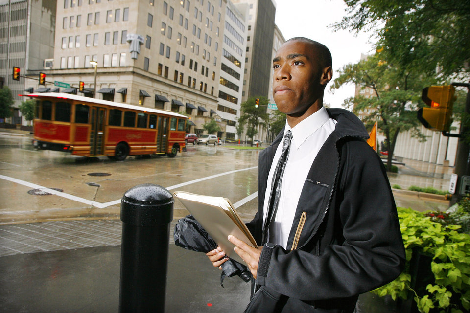 Trae McNeeley, Oklahoma City, visiting businesses with his resume in downtown Oklahoma City while job hunting Thursday, August 6, 2009. Photo by Paul B. Southerland, The Oklahoman