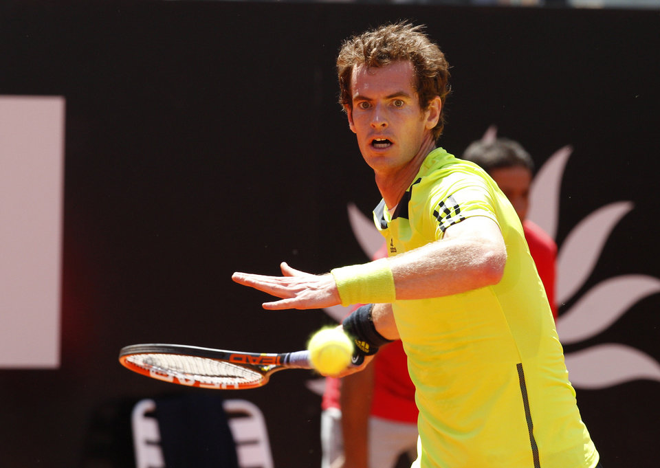 Photo - Britain's Andy Murray returns the ball to Spain's Marcel Granollers at the Italian open tennis tournament in Rome, Wednesday, May 14, 2014. (AP Photo/Riccardo De Luca)