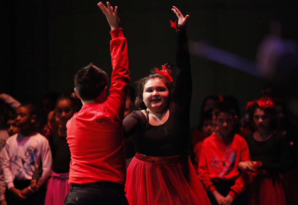 Photo - Christina Montoya, 11, dances with Joseph Dickson, 10, of Mark Twain Elementary.