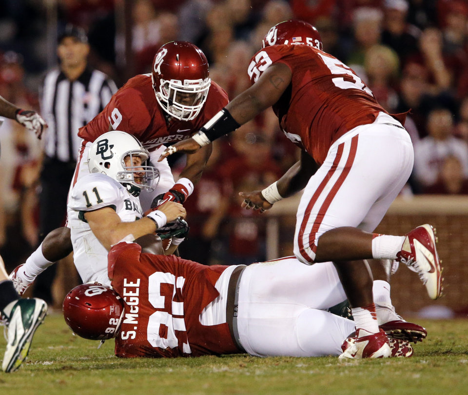 Oklahoma Sooners's Jordan Wade (93), Casey Walker (53) and Gabe Lynn (9) bring down Baylor Bear's Nick Florence (11) during the the second half of the college football game where  the University of Oklahoma Sooners (OU) defeated the Baylor University Bears (BU) 42-34 at Gaylord Family-Oklahoma Memorial Stadium in Norman, Okla., Saturday, Nov. 10, 2012.  Photo by Steve Sisney, The Oklahoman