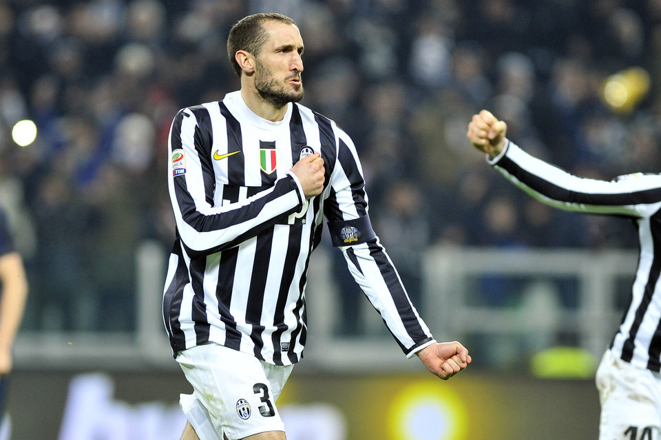 Photo - Juventus defender Giorgio Chiellini  celebrates after scoring during a Serie A soccer match between Juventus and Inter Milan at the Juventus stadium, in Turin, Italy, Sunday, Feb. 2, 2014. (AP Photo/Massimo Pinca)