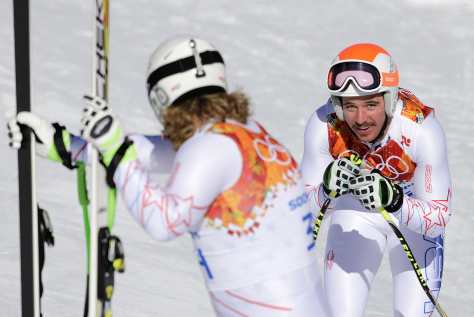 Photo - United States' Erik Fisher,left, and United States' Jared Goldberg catch their breath at the finish area during men's downhill training at the Sochi 2014 Winter Olympics, Thursday, Feb. 6, 2014, in Krasnaya Polyana, Russia.(AP Photo/Gero Breloer)