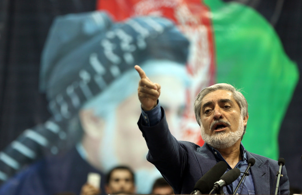 Photo - Afghan presidential candidate Abdullah Abdullah speaks during a gathering of his supporters in Kabul, Afghanistan, Tuesday, July 8, 2014. Abdullah says he received calls from President Barack Obama and U.S. Secretary of State John Kerry after he refused to accept the preliminary result of the vote citing fraud. Abdullah told his supporters the results of the election were fraudulent but asked them to give him a few more days to negotiate. (AP Photo/Massoud Hossaini)