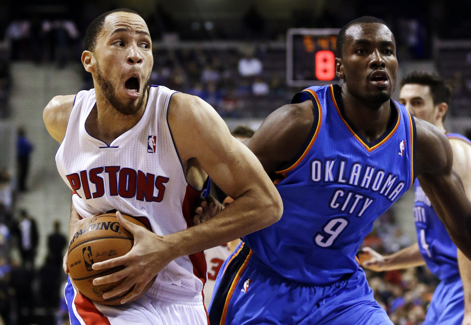 Detroit Pistons forward Tayshaun Prince (22) drives on Oklahoma City Thunder forward Serge Ibaka (9), of Congo, in the first half of an NBA basketball game in Auburn Hills, Mich., Monday, Nov. 12, 2012. (AP Photo/Paul Sancya)