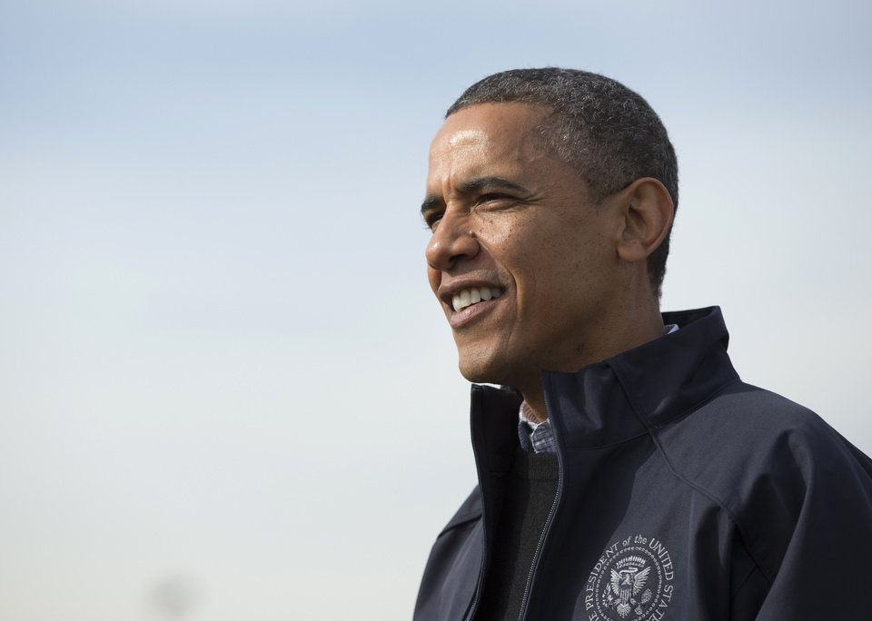 <p>President Barack Obama walks to greet people at the FEMA recovery center on the grounds of New Dorp High School, Thursday, Nov. 15, 2012, on Staten Island, in New York. (AP Photo/Carolyn Kaster)</p>