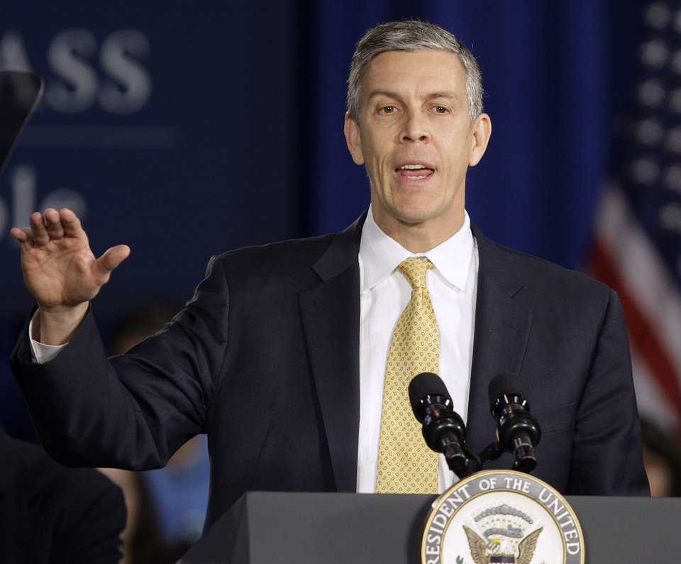 Photo - FILE - In this Jan. 12, 2012 file photo, Education Secretary Arne Duncan speaks at Lincoln High School in Gahanna, Ohio. School for thousands of public school students is about to get quite a bit longer. Five states announced Monday, Dec. 3, 2012, they will add at least 300 hours of learning time to the calendar in some schools starting in 2013. (AP Photo/Jay LaPrete, File)