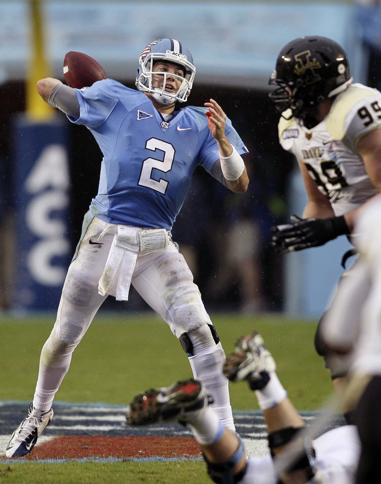 Photo -   North Carolina quarterback Bryn Renner (2) passes against Idaho during the first half of an NCAA college football game in Chapel Hill, N.C., Saturday, Sept. 29, 2012. (AP Photo/Gerry Broome)