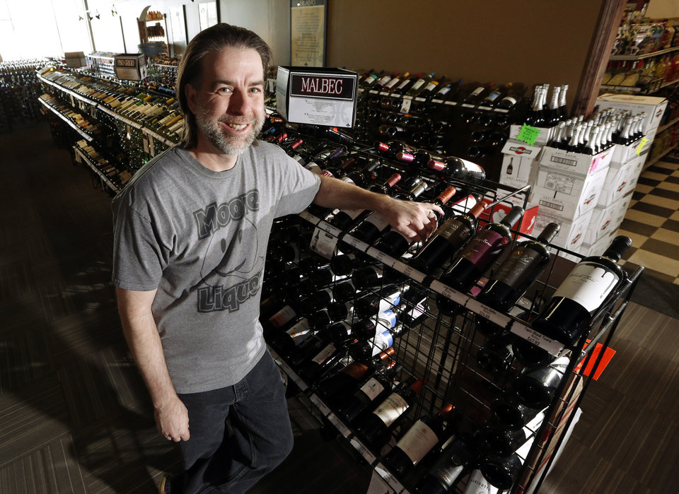Photo -  Bryan Kerr, President of the Retail Liquor Association of Oklahoma, is seen Wednesday at Moore Liquor in Moore. [Photo by Steve Sisney, The Oklahoman]