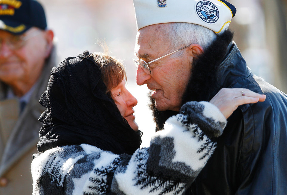 Photo - Barbara Miller of Midwest City felt like she had to walk over to Art Gruber, 88, a survivor of the attack on Pearl Harbor, and give him a hug after the ceremony  to commemorate the 70th anniversary of the Japanese attack on US forces at Pearl Harbor in 1941. Miller said she thanked Gruber for his service during the war and she said  he is