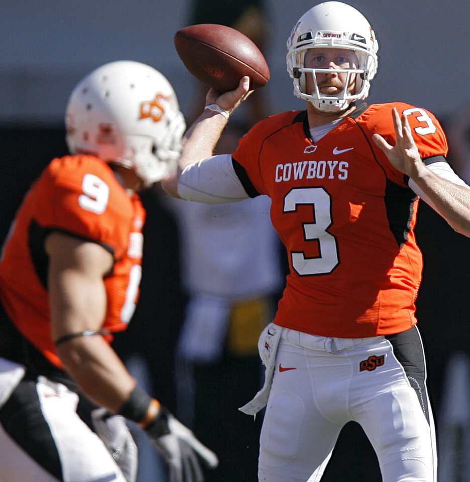 Photo - Oklahoma State's Brandon Weeden (3) looks to throw a pass to Bo Bowling (9) during the college football game between the Oklahoma State University Cowboys (OSU) and the Baylor University Bears at Boone Pickens Stadium in Stillwater, Okla., Saturday, Nov. 6, 2010. Photo by Chris Landsberger, The Oklahoman