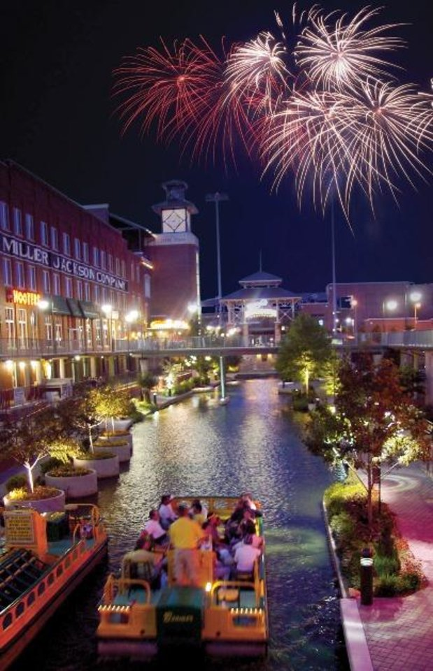 Photo -  Fireworks light up the sky above the Bricktown Canal. Photo provided