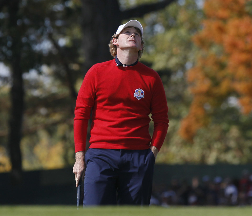 Photo - USA's Brandt Snedeker reacts after missing a putt on the first hole during a singles match at the Ryder Cup PGA golf tournament Sunday, Sept. 30, 2012, at the Medinah Country Club in Medinah, Ill. (AP Photo/Charles Rex Arbogast)  ORG XMIT: PGA124