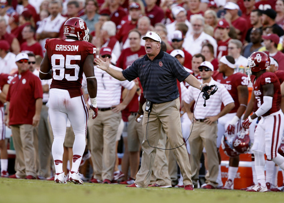 Photo - Assistant coach Mike Stoops directs Oklahoma Sooner Geneo Grissom (85) during a college football game between the University of Oklahoma Sooners (OU) and the Louisiana Tech Bulldogs at Gaylord Family-Oklahoma Memorial Stadium in Norman, Okla., on Saturday, Aug. 30, 2014. Photo by Steve Sisney, The Oklahoman