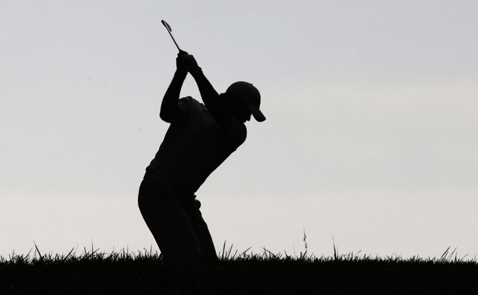Photo - Jason Day, of Australia, hits his tee shot on the 12th hole during the second round of the PGA Championship golf tournament at Valhalla Golf Club on Friday, Aug. 8, 2014, in Louisville, Ky. (AP Photo/David J. Phillip)