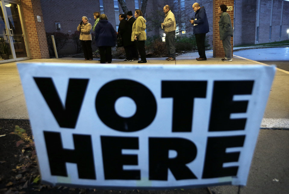 Photo -   Voters wait in line for the doors to Precinct 39 to open before casting their ballots on Election Day, Tuesday, Nov. 6, 2012, at the First Church of the Open Bible in Des Moines, Iowa. (AP Photo/Charlie Neibergall)